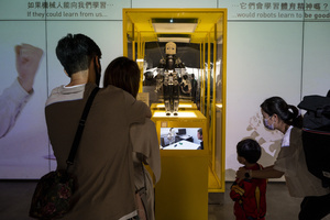 Visitors are seen during the 'ROBOTS' exhibition at the Hong Kong Science Museum in Hong Kong on May 8, 2021. The exhibition explores the 500-year story of humanoid robots and the artistic and scientific quest to understand what it means to be human.