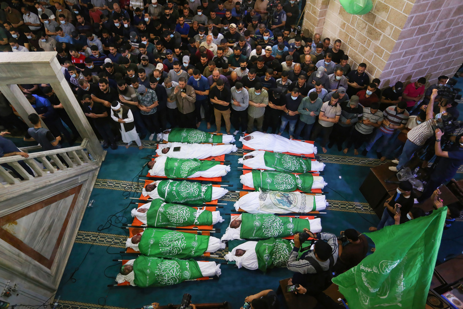 (Editors note image depicts death)Palestinians attend the funeral of 15 people who were killed in an Israeli air strike in Gaza City.The Israeli army has launched hundreds of air strikes on the Gaza strip since the beginning of the week,  while Palestinian militants have launched more than 1,  200 rockets,  according to Israel's army,  in some of the worst violence in seven years in the area. Days of violent confrontations between Israeli security forces and Palestinians in Jerusalem, various Palestinian militants' factions in Gaza launched rocket attacks since 10th May that killed at least six Israelis to date. Gaza strip's health ministry said that at least 65 Palestinians, including 13 children, were killed in the recent retaliatory Israeli airstrikes.