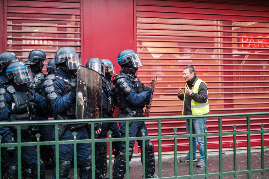 A protester confronts police officers during the demonstration.Protesters took to the streets of Paris as part of the International Workers Day protests to demand social and economic justice and voice their opposition to government plans to change unemployment benefits.