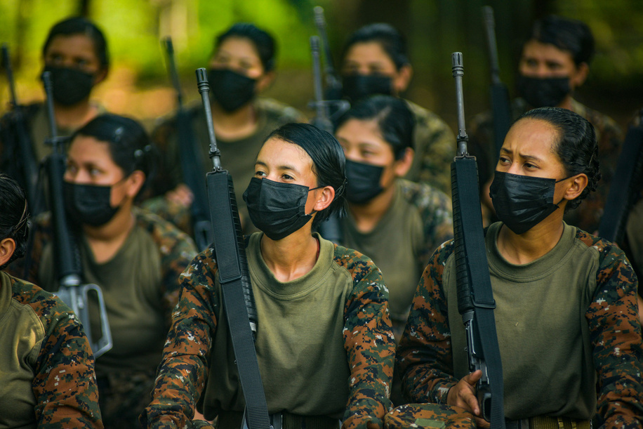 A soldier looks on as she listens to the instructions from her superior to perform military drills.On May 7th El Salvador celebrates the day of the Salvadoran soldier; the Salvadoran armed forces were founded in 1824. Currently, 194 women are in the process to enter the ranks of the armed forces.