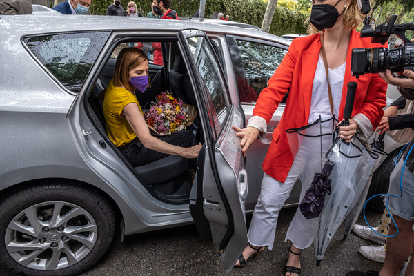 The former president of the Catalan Parliament, Carme Forcadell, gets into the car carrying a bouquet of flowers after being released from the Barcelona Women's Prison. The former president of the Catalan Parliament, Carme Forcadell, is released from the Women's Prison of Barcelona after the pardons to the leaders of the process for the Independence of Catalonia, granted by the Spanish Government.