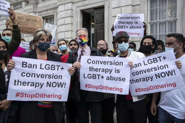 Peter Tatchell (C) and LGBT+ supporters hold placards expressing their opinion, during the demonstration against the use of Conversion Therapy outside UK Cabinet office.  Peter Tatchell, together with the other LGBT+ supports and lead activists, have handed in letters to the UK Cabinet office demanding the government to ban Conversion Therapy. Handing in 7,500-signature petition & letter to Liz Truss.
