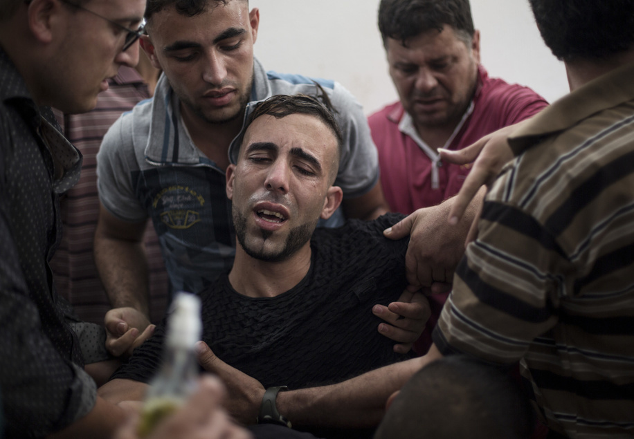 A relative of the deceased seen mourning. Ayman al-Najjar's funeral in Jabaliya refugee camp in the northern Gaza Strip. He was among two people killed in an Israeli air strike on the east Jabaliya refugee camp near the border with Israel.