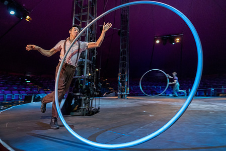 Performers seen with rings at 'Lexicon' circus performance at the Melbourne international festival.