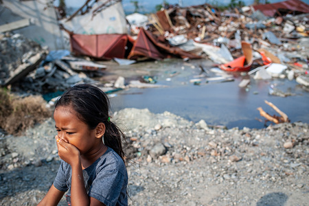 A resident is seen walking next to the ruins of a building that was destroyed by the earthquake. A deadly earthquake measuring 7.5 magnitude and the tsunami wave caused by it has destroyed the city of Palu and much of the area in Central Sulawesi. According to officials, the death toll from the devastating quake and tsunami has risen to 2088, around 5000 people in hospitals are seriously injured and some 62,000 people have been displaced.