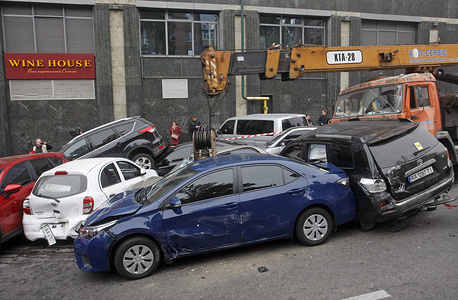 A general view of damaged cars during a large-scale road traffic accident in center of Kiev. As local media reported, about 17 cars was rammed and damaged after a mobile truck crane with non-working brakes crashed into passenger cars, according to preliminary data.