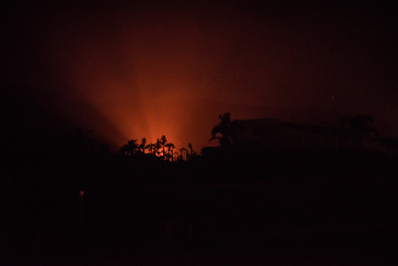 The Woolsey Fire burns late into the night in Malibu. The Woolsey fire has already burned more than 70,000 acres as it continues to grow while reaching the Pacific Coast at Malibu.