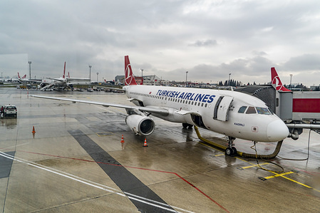 Turkish Airlines airplanes are seen at the Istanbul Ataturk Airport during a rainy day. Turkish Airlines is a state owned airline, member of Star Alliance, with 329 airplane fleet and 220 more aircraft orders. Istanbul IST/LTBA airport will soon be replaced by the new Istanbul Mega Airport.
