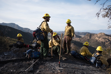 Members of The Scorpions are seen resting after tirelessly clearing breaks in brush, in effort to stop Woolsey fire from spreading. Woolsey Fire has burned  96,949 acres of land and claimed around 435 structures in it's path, leaving three confirmed dead.