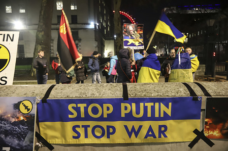 STOP PUTIN, STOP WAR banner seen before the protesters during the protest. Ukrainians protest against Putin and Russia in the centre of London, UK as the recent escalating political and military tension between the countries for fear of a war raise.