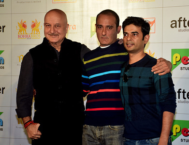 Actor Anupam Kher (L), with co-actor Akshaye Khanna (C), and Director Vijay Ratnakar Gutte (R), seen during the trailer launch of upcoming Political Drama film 'The Accidental Prime Minister' at PVR, Juhu in Mumbai. The film is based on the eponymous book by former Prime Minister Dr. Manmohan Singh's media advisor Sanjaya Baru.