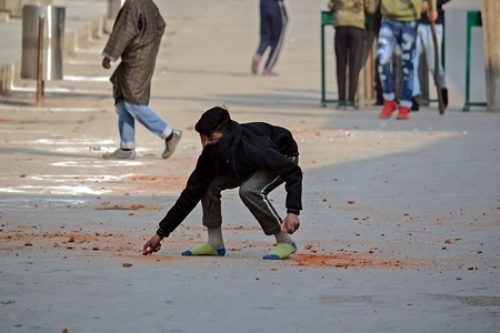 A Kashmiri demonstrator seen preparing to throw stones at government forces during clashes in Srinagar, Indian administered Kashmir. Clashes erupted between Kashmiri protesters and Indian government forces during the protests soon after the Friday congregational prayers ended in the Grand Mosque in Srinagar.