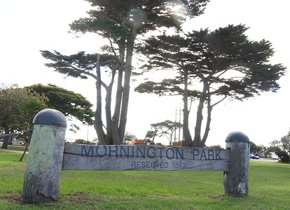 Mornington park sign seen at the seaside town on the Mornington Peninsula, Victoria, Australia, located 35 miles south of Melbourne's central business district. As such. Mornington is a popular tourist destination with Melburnians who often make day trips to visit the area's bay beaches and wineries.