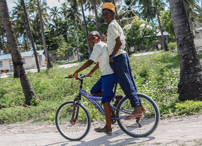Young boys seen cycling back to school.