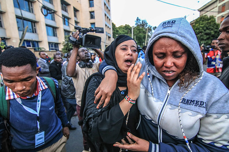 Family members are reunited after escaping an explosion related to a terrorist attack against a hotel in Nairobi.The attack started at around 3:30 pm when an unknown number of armed gunmen with one suicide bomber launched an assault on the D2 Dusit Hotel in Nairobi Kenya. The attack left 2 dead and several injured.