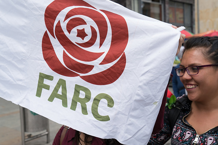 A woman seen holding a FARC (Revolutionary Armed Forces of Colombia) flag during a demonstration organised by the 'labor union workers' against the President Juan Manuel Santos and it's economic and social policies.