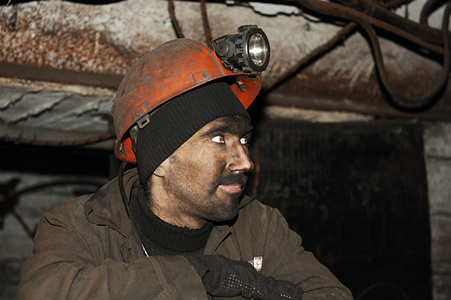 A coal miner seen returning from his shift 1200 meters below the surface, Despite being dirty and tired his spirits is high. The State owned Kalinin Coal Mine is situated in Central Donetsk City in the new separatist state of The Donetsk Peoples Republic, (DPR) in Eastern Ukraine. Since 2014 their area has been into conflict with the Ukraine. Despite the depletion of workforce numbers due to volunteers fighting on the front-line, it still has 800 miners. Approximately 250 are present on any one shift which lasts 6 hours. The Donbass region is still a well-recognised and productive coal mining location. Millions of tonnes are transported to Russia annually.