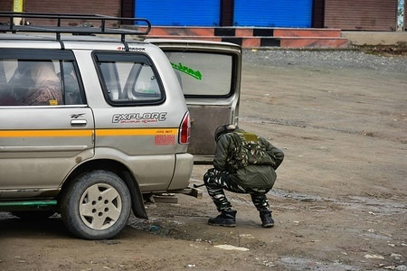 A paramilitary trooper seen inspecting a passenger vehicle close to the site of blast in Lethpora, about 28 kms from Srinagar, Indian administered Kashmir.  At least 49 paramilitary troopers were killed in one of the deadliest militant attacks in Kashmir when a  suicide bomber rammed his explosive-laden car into a Central Reserve Police Force (CRPF) convoy. Jaish-e-Muhammad militant group had claimed the responsibility for the attack.