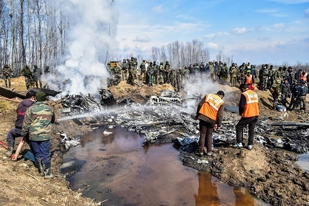 Firefighters spray water into the wreckage of an Indian military aircraft which crashed in Budgam, 20kms from Srinagar, Kashmir. An Indian Air Force aircraft crashed on Wednesday in Budgam district of Kashmir, killing seven persons including six Indian Air Force personnel and one civilian. The aircraft crashed due to technical reasons, officials said.