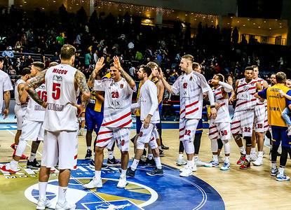 Players from AX Armani Exchange Olimpia Milan seen celebrating their victory during AX Armani Exchange Olimpia Milan against Khimki Moscow in the 2018/2019 Turkish Airlines Euro league Regular Season round 25 match. Olimpia Milan won 90-88.