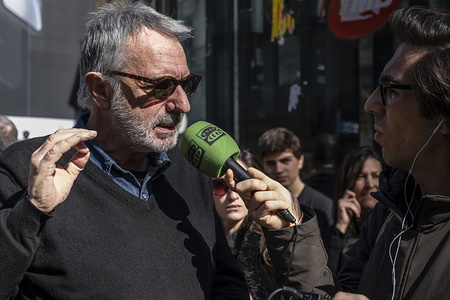 The artist Frederic Amat, author of the famous drawing of the name of Barcelona where the letter L has been replaced by a bow is seen during the ceremony.  Unveiling of the memorial inscription in memory of the victims of the attack on La Rambla which occurred on August 17, 2017 when a van drove into the center of the promenade causing numerous casualties and injuries. The memorial includes one of the phrases selected from the thousands of messages of solidarity expressed by the citizenship: Peace be upon you, oh city of peace.orial includes one of the phrases selected from the thousands of messages of solidarity expressed by the citizenship: Peace be upon you, oh city of peace.
