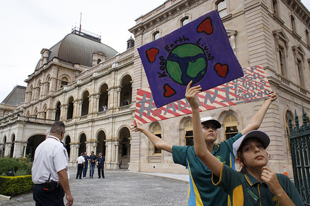 Students seen holding placards  at Queensland Parliament House during the protest. School and university students, teachers, parents and other protesters marched from Queen's Gardens to Queensland Parliament House taking part in the School Strike 4 Climate protest and March. They call for government action on climate change policy. Australia.