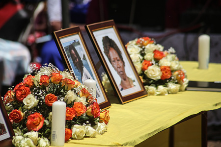 Portraits of  the victims seen during the memorial service. Neighbors to the victims of the Ethiopian Airways Flight ET302 crash held a memorial service in Nakuru Kenya. Five members of one family perished in the ill-fated flight.