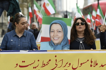 Protesters are seen carrying a placard with the photo of Ms Maryam Rajavi, president-elect of the Iranian Resistance. Members of the Anglo-Iranian communities and supporters of the National Council of Resistance of Iran (NCRI) gathered for a rally in London to express solidarity with flood victims in Iran and condemn the regime for mobilising the revolutionary Guard (IRGC) to confront the popular protests against the lack of relief.
