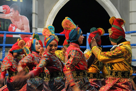 """Students in Aceh seen performing the """"Ratoh Duek"""" traditional dance in Lhokseumawe City. The Ratoh Duek is a famous dance from Aceh province which is performs by 13 women, 11 dancers and 2 syahie, full of enthusiasm as a description of the interaction of everyday life and cohesiveness of Acehnese society, even this dance has been promoted in several foreign countries with display of syari'at islam."""