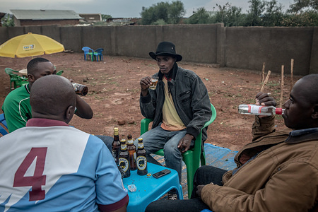 Men seen drinking beer at a bar in Nakivale refugee settlement south west Uganda. Nakivale was established in 1958 and officially recognized as a refugee settlement in 1960. The settlement hosts more than 100,000 refugees from Burundi, the Democratic Republic of Congo, Eritrea, Ethiopia, Rwanda, Somalia, Sudan, and South Sudan.