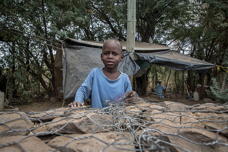 A child seen in Kakuma refugee camp, northwest Kenya. Kakuma is home to members of the local Turkana community and the nearby refugee camps shelter roughly 190,000 refugees from countries including Ethiopia, Burundi, Somalia, Tanzania and Uganda.
