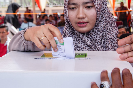 A woman seen casting her ballot during pre-election drill for president, vice-presidential candidates and legislative candidates in Lhokseumawe, Aceh province, Indonesia. Elections in Indonesia will take place next week on Wednesday April 17, 2019.