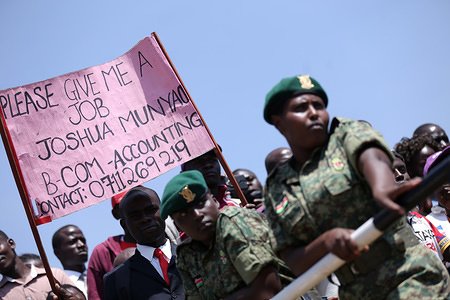 Middle-aged man seen holding a banner seeking for employment during the celebrations. Kenyans celebrated Labour Day at Uhuru Park in Nairobi where some Youths protested against rampant corruption and poor leadership in Kenya. Unemployment and underemployment is widespread in the country.