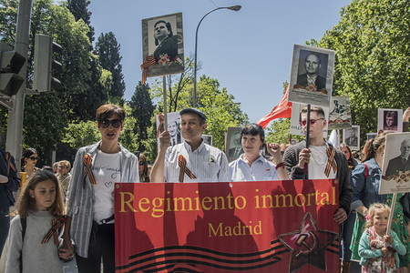 Members of the Russian Hispano community in Madrid take part in a march to celebrate the victory of the Soviet Union in the Second World War at Prado Avenue.