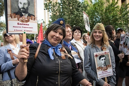 Participants seen holding pictures during the celebrations. Thousands of Russian citizens participated in the celebrations for the anniversary of the victory against fascism, which has been established as a Victory Day. With the military parade as well as the demonstration, the festive event took place across Russia, with citizens holding photos of their relatives who have either fought or been killed during the World War.
