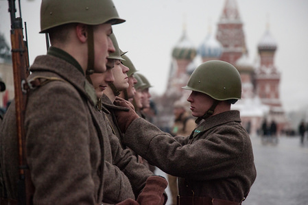 A soldier seen helping to tidy his fellow soldier's uniform before the military parade. Russian soldiers and volunteers dressed in historical uniforms take part in the parade in Red Square in Moscow. The parade marked the 76th anniversary of a World War II historic parade in Red Square.