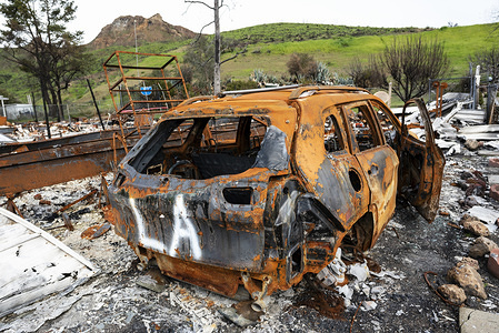 A burned car is seen in the aftermath of the deadly Woolsey wid fire in Agoura Hills, California. Thousands of fire fighters battled the 2018 Woolsey brush fire in southern California as tens of thousands of people were under mandatory evacuation. 1500 destroyed - 341 damaged, structures were destroyed and damaged, 3 fire fighters were injured and 3 civilian fatalities encountered. The cause of the fire is still uncertain.