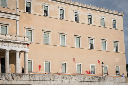Red paint seen on Hellenic Parliament building. Unidentified men threw red paint at the Hellenic Parliament.