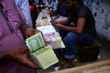 A vendor seen with real banknotes at Gulistan in the capital ahead of Eid-Ul-Fitr. Real Banknotes are on sale before each Eid due to the tradition, where children love to get them as Eid gifts from the elders.