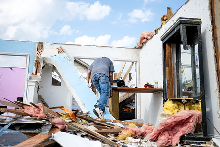 Adam removes personal belongings from his childhood home that was struck by a tornado the night before. At least 1 person is dead and 12 injured from the storms that hit western Ohio.