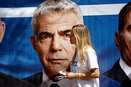 A supporter of Yair Lapid waits for his arrival at a polling station in Tel Aviv, Israel. Israel will hold a national election after Prime Minster Benjamin Netanyahu failed to build a coalition government with former Defense Minister, Avigdor Lieberman.
