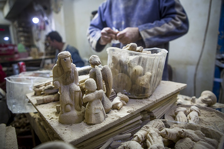 Christmas wood carvings seen at the carpentry. The historic small carpentry in Bethlehem was designed by the Giacaman brothers, artists of wood. It produces all Christmas items that Christian people buy from shops and markets in various parts of the world and considered to be from the holy land.