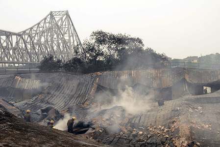 Aftermath of a massive fire that destroyed a chemical plant near Howrah's Jagannath Ghat. The cause of the fire and damages are still uncertain as the police is still investigating the cause of the fire.
