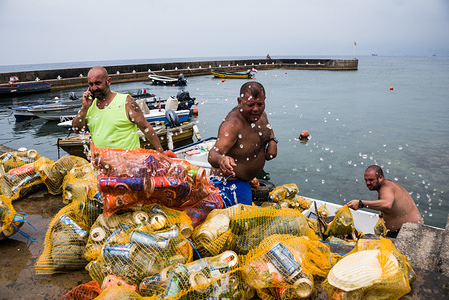 Calypso Dive Club members clear trash from the sea along Beirut's Corniche during the clean up day. Lebanese people came out to help with a National Beach Clean up Day spearheaded by the Lebanese Minister for Environment. Not only did they collect trash from their beaches at over 150 locations, teams of scuba divers also spent their day underwater, clearing up everyone's waste from the ocean floor. Beirut, Lebanon.