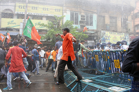 Police officers fire Water Canons towards the protester during the demonstration. The BJP leaders announced a protest march towards Laalbazar, Police HQ of West Bengal after three of its workers were killed in violence in Sandeshkhali in North 24 Parganas district last week. Their protest march to the Kolkata Police headquarters in the city's Lalbazar area turned violent on Wednesday as the party workers clashed with the police. The police used water cannons and charged Tear Gas to the demonstrators when they tried to break barricades at Central Avenue and threw stones and bricks at the police. The march began around 12 noon at Subodh Mullick Square in Central Kolkata and moved towards Lalbazar from different directions.
