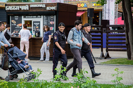 Law enforcement officers detain a participant during the rally. Police and hundreds of demonstrators faced off in central Moscow during an unauthorized march against police abuse involving the detention of a high-profile Russian investigative journalist, Ivan Golunov.