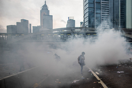 A protester seen surrounded by tear gas that was used by the police to dismiss the crowd.  Thousands of protesters occupied the roads near the Legislative Council Complex in Hong Kong to demand to government to withdraw the extradition bill. The Hong Kong government has refused to withdraw or delay putting forward the bill after hundreds of thousands of thousands of people marched against it on Sunday.