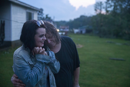 Nicole Rood and her boyfriend Brett Cantrell hug after they survived a tornado in the 6400 block of West Cowden Rd. near Ellettsville. Brett Cantrell survived by hanging onto a tree, and Rood hung onto the handle of the front door of a house. The couple were in their car when the storm stuck. The tornado destroyed several homes, tore up trees, and left dangerous live power lines scattered around the area.