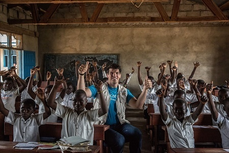 Retired Irish rugby player and UNICEF Ambassador Donncha O'Callaghan poses for a picture in a classroom of children being taught about the symptoms of Ebola. The Democratic Republic of Congo is currently experiencing the second worst Ebola outbreak in recorded history.