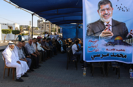 Palestinians seat at a mourning tent for the former Egyptian president Mohamed Mursi, in Khan Younis, southern Gaza Strip.